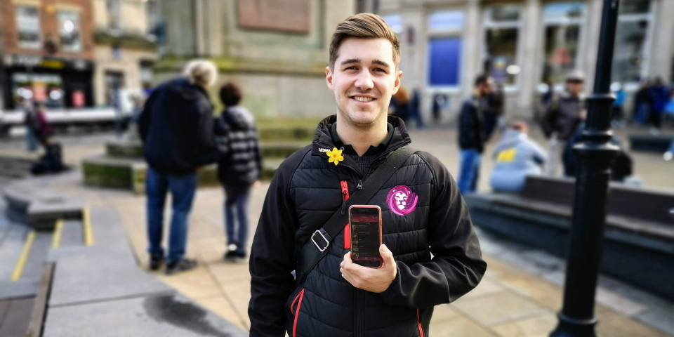 Andrew Bartlett using his ROAM app in Durham city centre