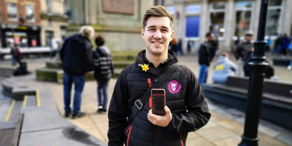 Andrew Bartlett using his ROAM app in Durham city centre