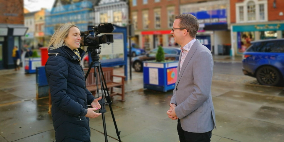 Graham Soult being interviewed in Morpeth Market Place by ITV's Katie Cole